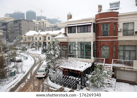 snow covered building during snowstorm - stock photo