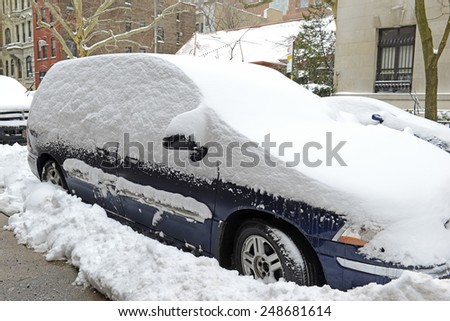 Snow covered car after winter snowstorm, New York City - stock photo