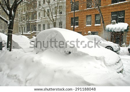 Snow covered cars in street after snowstorm, Manhattan, New York - stock photo
