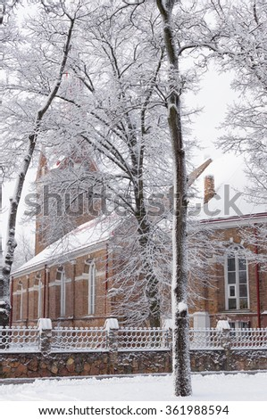 snow-covered church. Church building in early winter morning. Breathe the air of Christmas spirit.