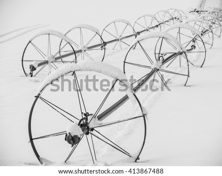 Snow covered farm equipment for irrigation