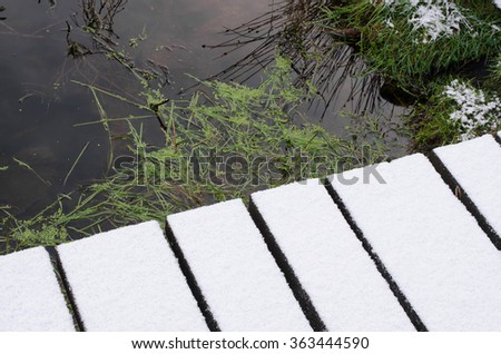 snow covered footbridge, bog - stock photo