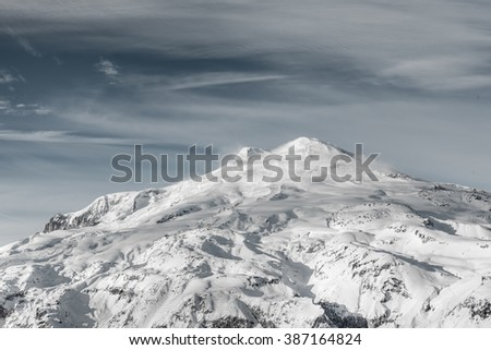 Snow covered Greater Caucasus mountains at winter sunny day. View from Elbrus slope, Kabardino-Balkaria, Russia - stock photo