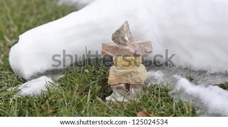 snow covered inukshuk in cold winter scene - stock photo