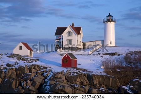 Snow covered lighthouse during holiday season in Maine. - stock photo