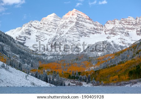 Snow Covered maroon bells Mountains with Golden Aspen Trees  - stock photo