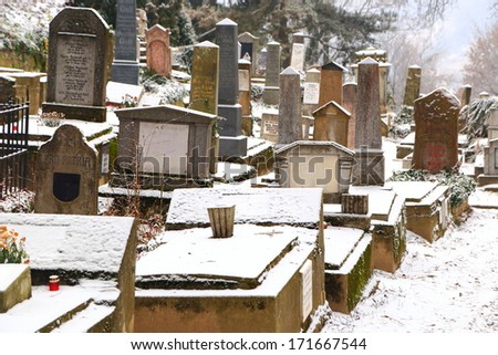 Snow covered monuments in old graveyard, Sighisoara, Romania - stock photo