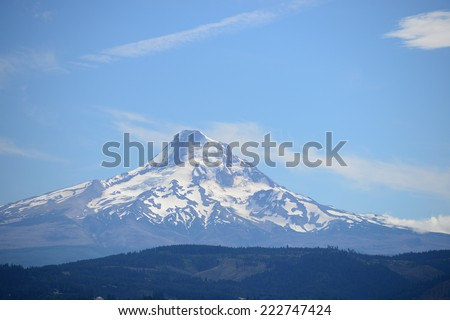 snow covered mount hood with afternoon sunlight