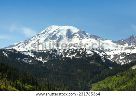 Snow covered Mount Rainier in Washington state in Spring time - stock photo