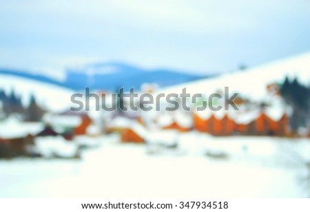 Snow covered mountain holiday house at winter - stock photo