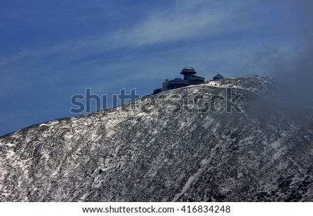 Snow-covered mountain slope and shelter in the Giant Mountains, Poland