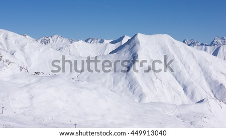 Snow covered mountain summits in the Austrian alps near Innsbruck, Tyrol, Austria.