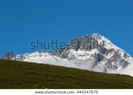 Snow covered mountains against blue sky background. Caucasus, Georgia - stock photo