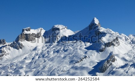 Snow covered mountains Chaiserstock