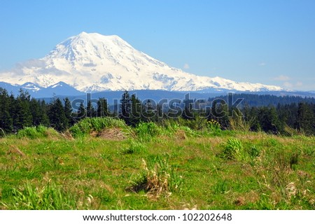 Snow covered Mt Rainier on a sunny Spring day
