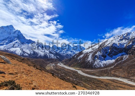 Snow covered peaks and glacier valley in Himalaya - stock photo