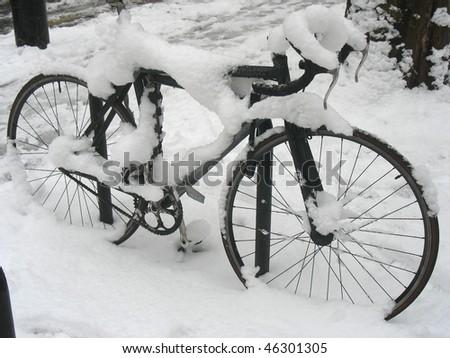 Snow covered racing bike - stock photo