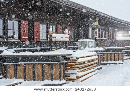 snow-covered restaurant in mountains
