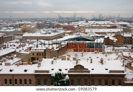 Snow covered roofs on background of dock; St. Petersburg; Russia.