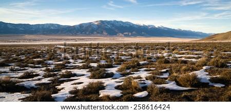 Snow Covered Sage Brush Mountain Landscape Surrounding Great Basin Nevada - stock photo