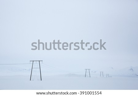 Snow covered sander with telephone pylons receding into background, Southern Iceland - stock photo