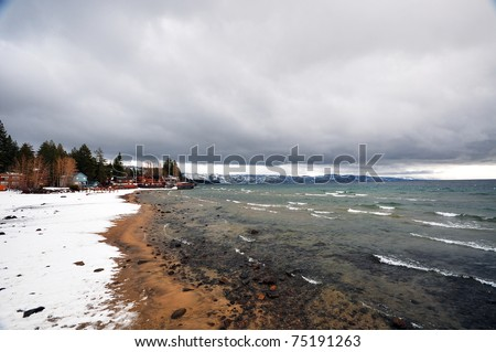 Snow-Covered Shore in Stormy Day in Lake Tahoe City, CA - stock photo
