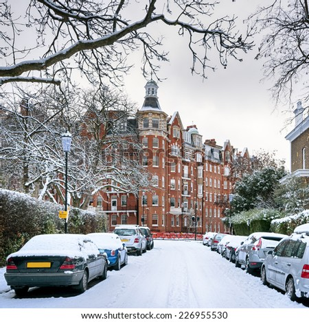 Snow covered street in Kensington, London - England. - stock photo