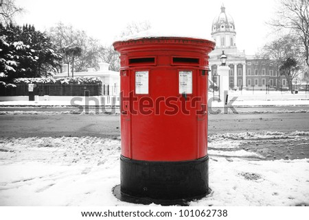 Snow covered traditional british red post box, London - stock photo
