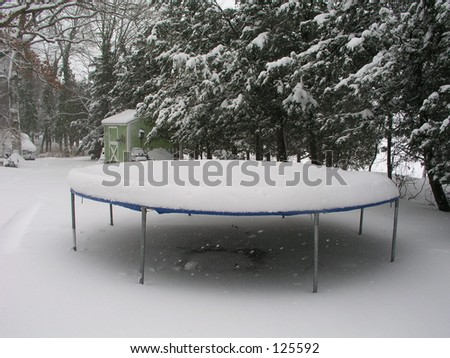 snow covered trampoline - stock photo