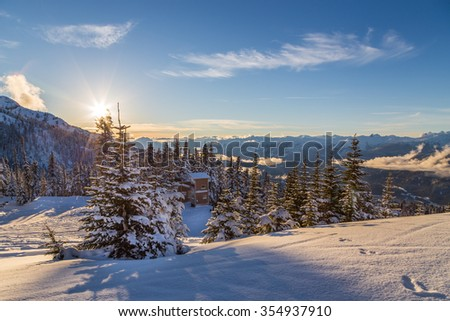 Snow covered trees with Whistler Creekside valley in the background.  - stock photo