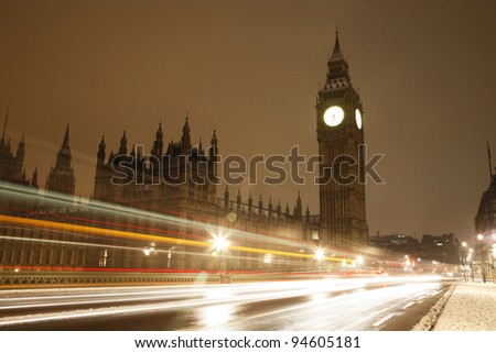 Snow Covered Westminster, seen from South Bank, at dawn. - stock photo