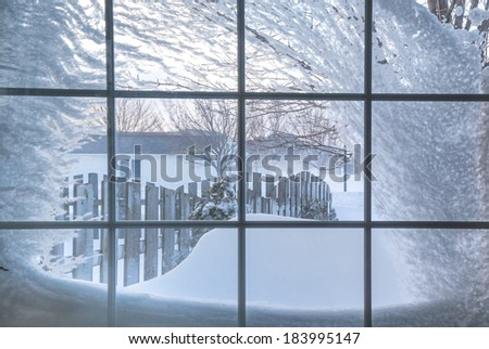 Snow Covered Window With A View Out Into Residential Neighborhood