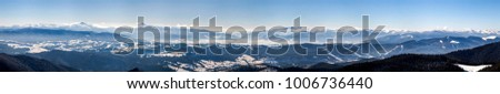 Snow covered winter mountains. Arctic landscape. Colorful outdoor scene, Artistic style post processed photo.
