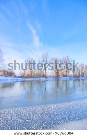 snow-covered winter river - stock photo