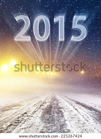 Snow covered winter way leading in new year - stock photo