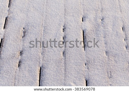 Snow covered wood terrace floor background texture - stock photo