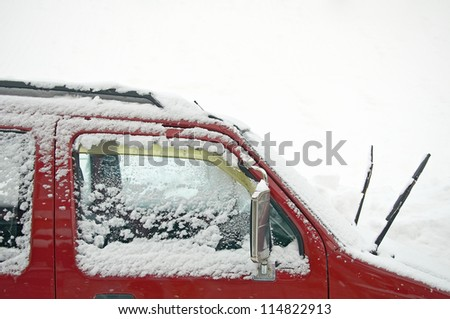 snow covers on car's window as snowing weather