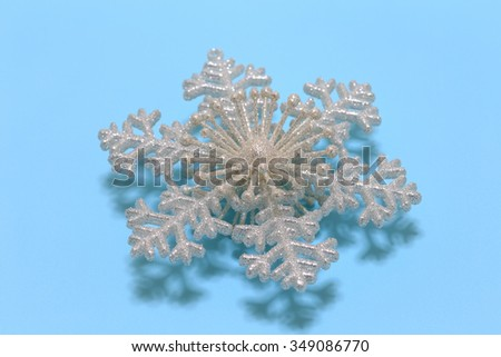 Snow crystal on blue background