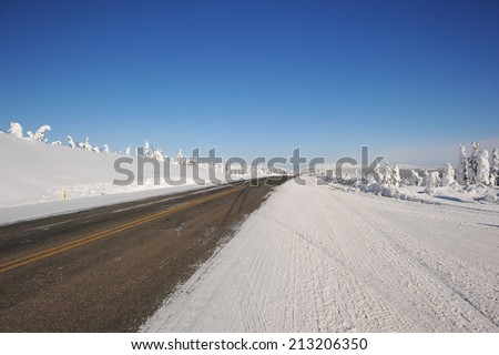 snow Dalton highway in alaska in winter - stock photo