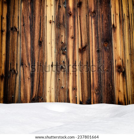 Snow drift on wood boards with blank space - stock photo