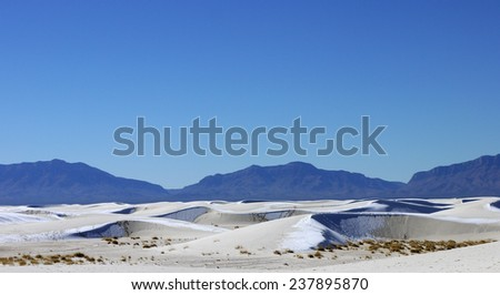 Snow Dusted Sand Dunes at White Sands National Monument, New Mexico, USA - stock photo