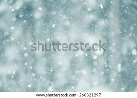 Snow falling abstract with a shallow depth of field for a dreamy look.