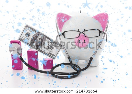 Snow falling against pink and white piggy bank wearing glasses and stethoscope - stock photo