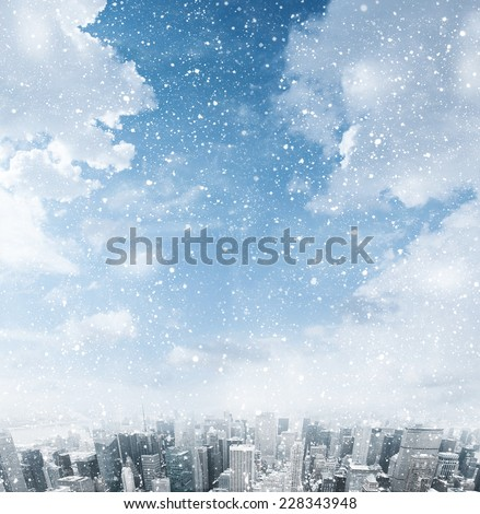Snow falling down over the city - stock photo