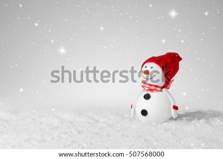 Snow falling on a White Christmas decoration snowman