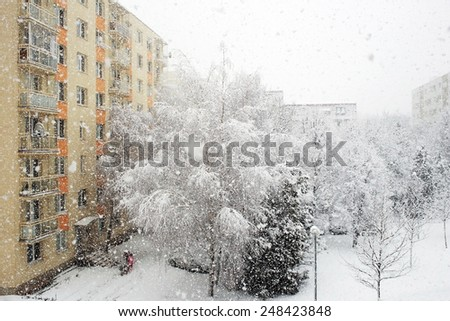 snow falls and residential building in Trnava - stock photo