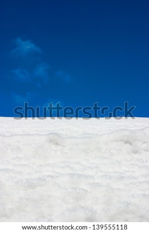 Snow field with blue sky
