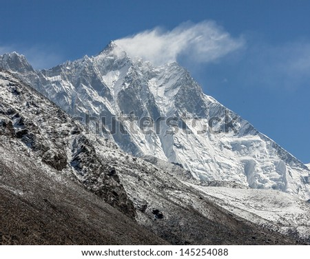 Snow flags on the top of the Lhotse (8516 m) - Everest region, Nepal, Himalayas - stock photo