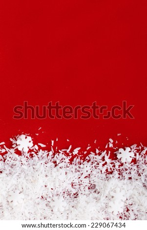 snow flakes on Christmas red background - stock photo