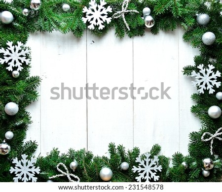 Snow flakes on fir leaves.frame.Image of Christmas. - stock photo